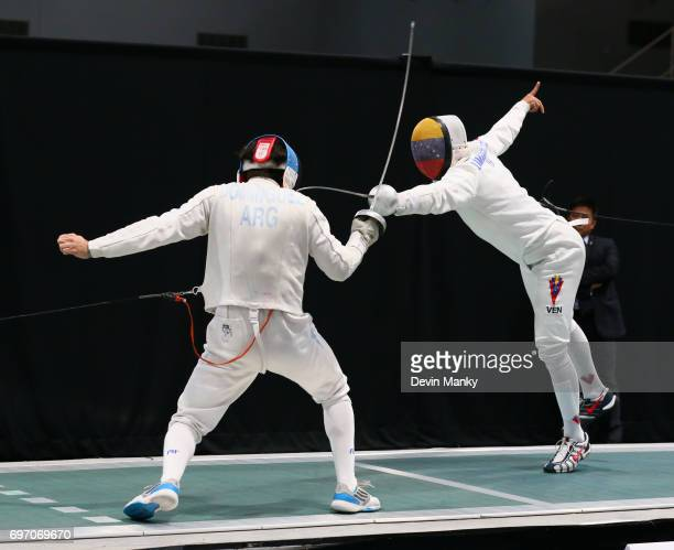 Jesus Andres Lugones Ruggeri of Argentina fences against Ruben Limardo Gascon of Venezuela during the gold medal match of the Team Men's Epee event...