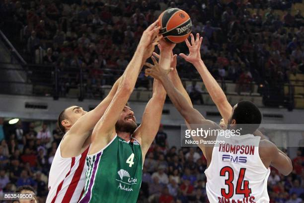 Jesus Caballero #4 of Unicaja Malaga competes with Hollis Thompson #34 of Olympiacos Piraeus during the 2017/2018 Turkish Airlines EuroLeague Regular...