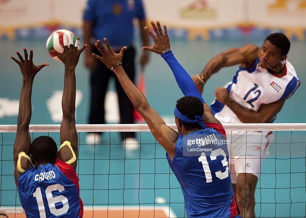 Jesus Chourio and Ivan Marquez of Venenzuela and Bell Cisnero Henry during the men's volleyball in the 2011 XVI Pan American Games at Pan American volleyball complex on October 25, 2011 in Ciudad Guadalajara, Mexico.