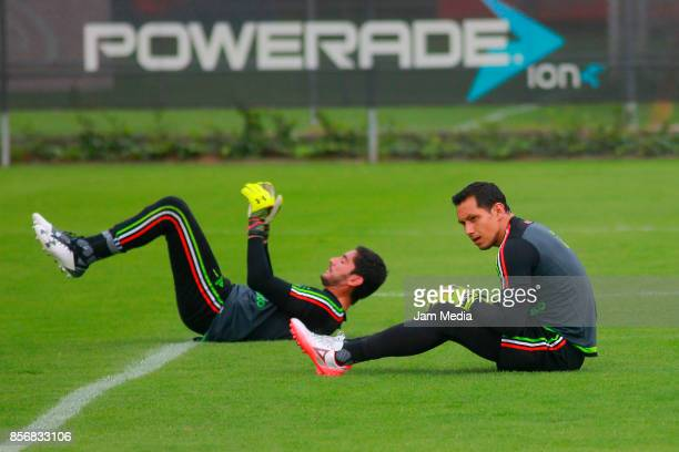 Jesus Corona and Rodolfo Cota goalkeepers of Mexico warm up during a training session at CAR on October 02 2017 in Mexico City Mexico