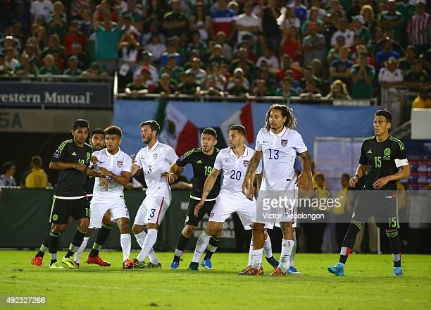 Jesus Corona Carlos Salcido Oribe Peralta and Hector Moreno of Mexico vie for position with DeAndre Yedlin Brad Evans Geoff Cameron and Jermaine...