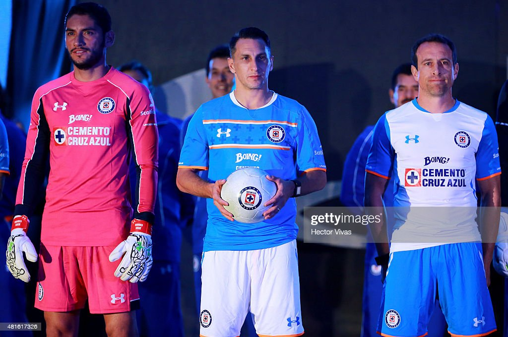 Jesus Corona Christian Gimenez and Gerardo Torrado of Cruz Azul pose for pictures during the presentation of the new kit at Club Deportivo La Noria...