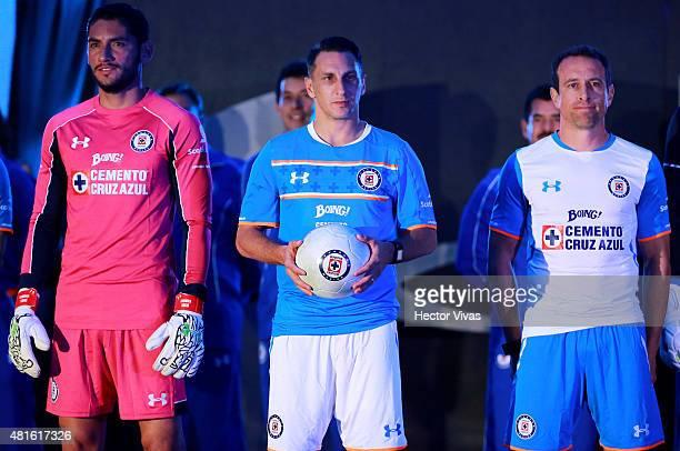 Jesus Corona Christian Gimenez and Gerardo Torrado of Cruz Azul pose for pictures during the presentation of the new kit at Club Deportivo La Noria...
