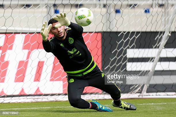 Jesus Corona goalkeeper of Mexico dives for the ball during a Mexico training session at Marlins Park on February 09 2016 in Miami United States