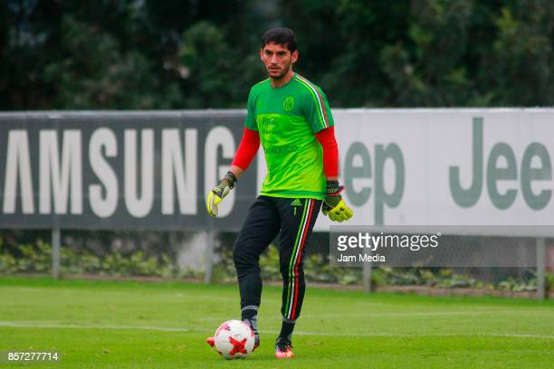 Jesus Corona goalkeeper of Mexico kicks the ball during a Mexico's National Team training session ahead of the Qualifier match against Trinidad...