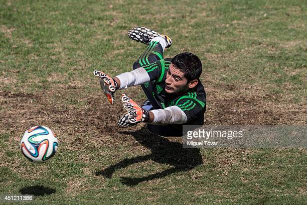 Jesus Corona goalkeeper of Mexico tries to stop the ball during a Training Session at O'Rei Pele Training Center on June 25 2014 in Santos Brazil