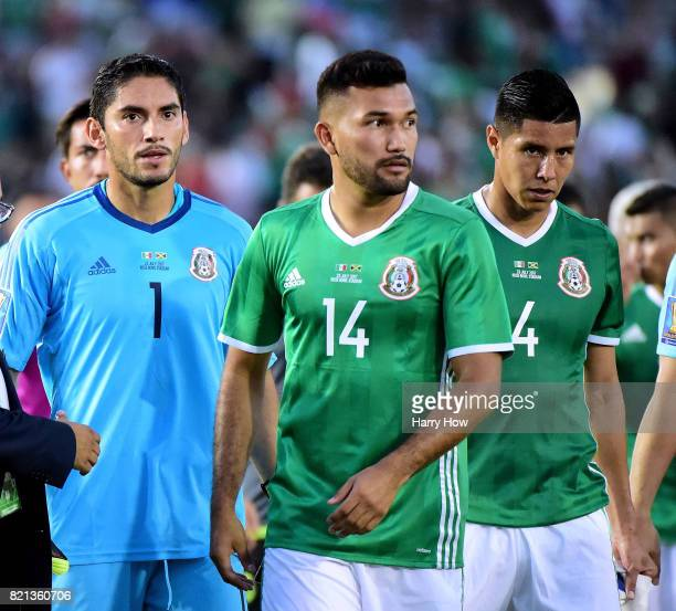 Jesus Corona Hedgardo and Hugo Ayala of Mexico react to a 10 loss to Jamaica during the CONCACAF 2017 semifinal at Rose Bowl on July 23 2017 in...