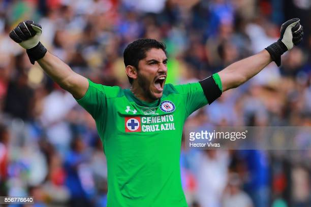 Jesus Corona of Cruz Azul celebrates the fourth goal of his team scored by his teammate Felipe Mora during the 12th round match between Pumas UNAM...