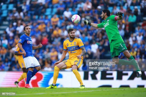 Jesus Corona of Cruz Azul deflects the ball as AndrePierre Gignac of Tigres awaits to go for a header during the 15th round match between Cruz Azul...