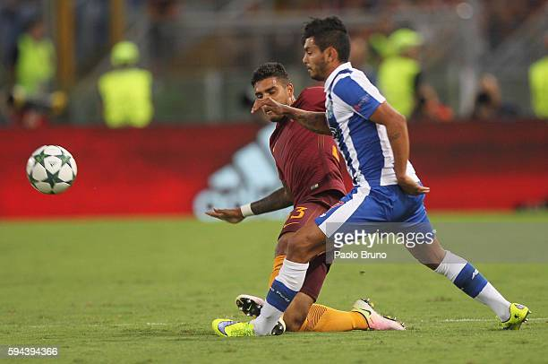 Jesus Corona of FC Porto fight for the ball with Emerson of AS Roma during the UEFA Champions League qualifying playoff round second leg match...