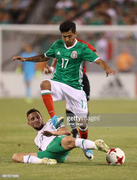 Jesus Corona of Mexico and Conor Hourihane of Ierland during the friendly match between the Republic of Ireland and Mexico at MetLife Stadium on June...