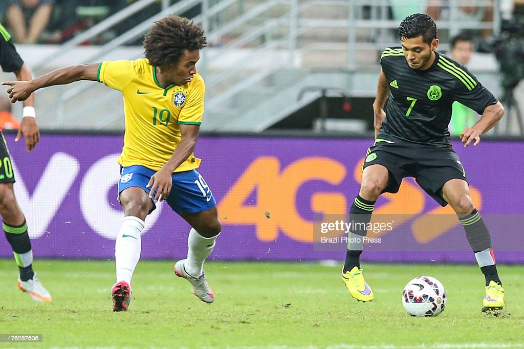 Jesus Corona of Mexico and William of Brazil vie for the ball during a friendly match between Brazil and Mexico at Allianz Parque Stadium on June 07...
