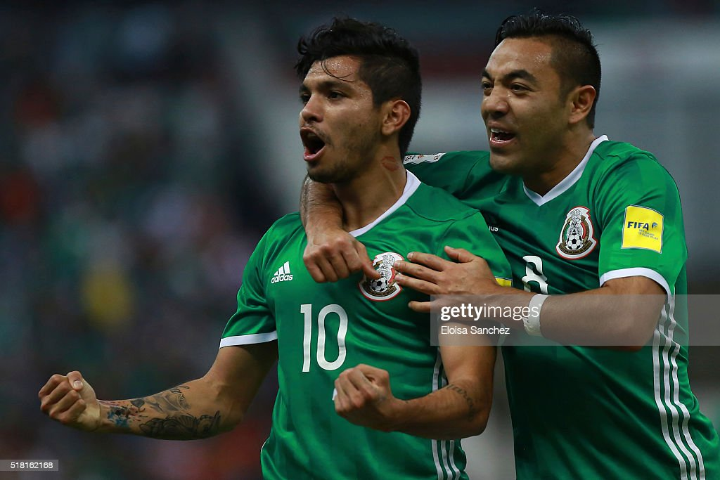 Jesus Corona of Mexico (#10) celebrates with teammate Marco Fabian de la Mora (#8) after scoring the second goal of his team during the match between Mexico and Canada as part of the FIFA 2018 World Cup Qualifiers at Azteca Stadium on March 29, 2016 in Mexico City, Mexico.