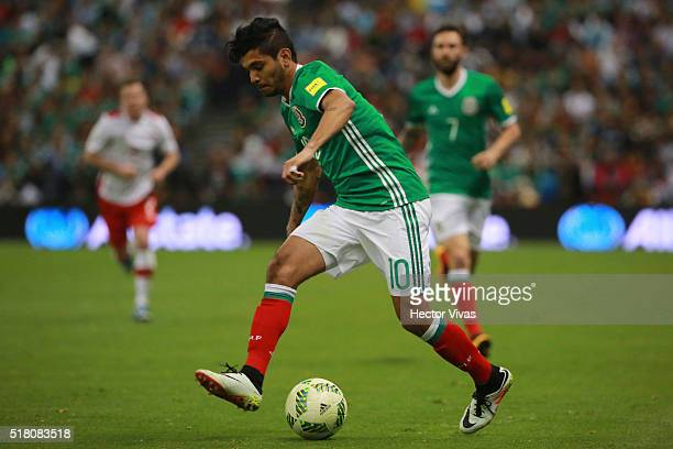 Jesus Corona of Mexico drives the ball during the match between Mexico and Canada as part of the FIFA 2018 World Cup Qualifiers at Azteca Stadium on...
