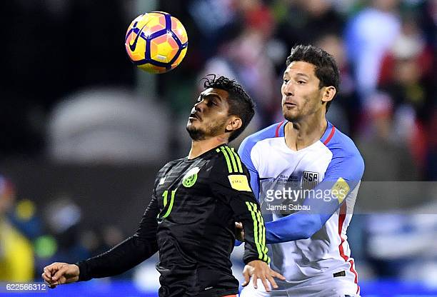 Jesus Corona of Mexico heads the ball against Omar Gonzalez of the United States in the first half during the FIFA 2018 World Cup Qualifier at MAPFRE...