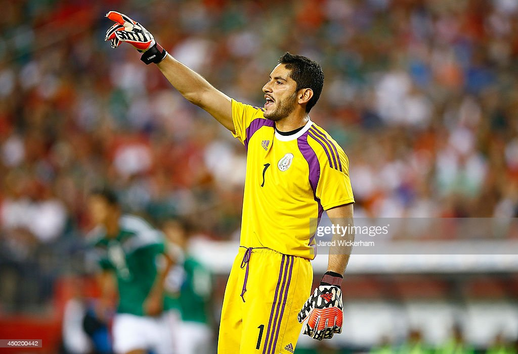 Jesus Corona #1 of Mexico yells instructions to his team in the first half against Portugal during the international friendly match at Gillette Stadium on June 6, 2014 in Foxboro, Massachusetts.