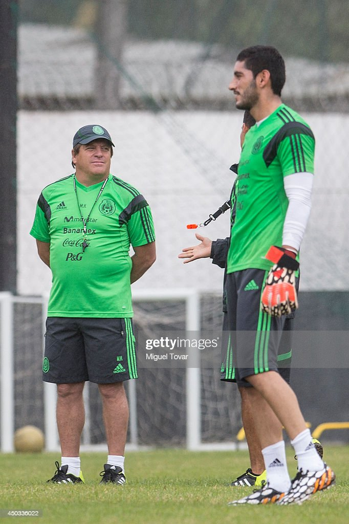 Jesus Corona of Mexico's National Soccer Team smiles as Miguel Herrera looks on during a training session at O' Rei Pele Training Center on June 09, 2014 in Santos, Brazil.