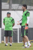 Jesus Corona of Mexico's National Soccer Team smiles as Miguel Herrera looks on during a training session at O' Rei Pele Training Center on June 09...