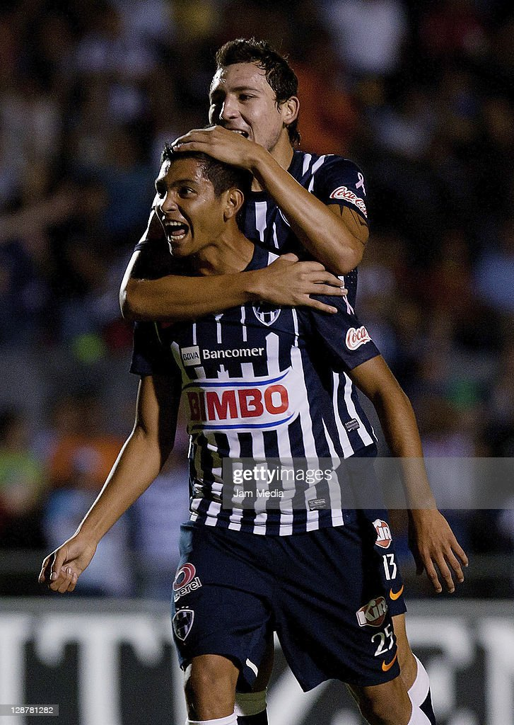Jesus Corona of Monterrey (L) celebrates with teammates a scored goal during a match against Estudiantes as part of the Apertura 2011 at 3 de Marzo Stadium on October 07, 2011 in Guadalajara, Mexico