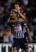 Jesus Corona of Monterrey celebrates with teammates a scored goal during a match against Estudiantes as part of the Apertura 2011 at 3 de Marzo...