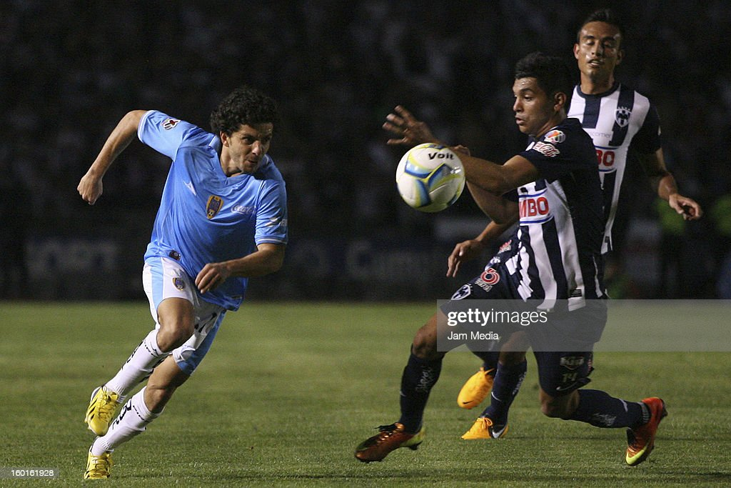 Jesus Corona (R) of Monterrey struggles for the ball with Guillermo Rojas (L) of San Luis during a match between Monterrey v San Luis as part of the Clausura 2013 Liga MX at Tecnologico Stadium on January 26, 2013 in Monterrey, Mexico.
