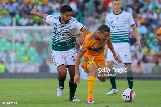 Jesus Dueñas of Tigres and Diego de Buen of Santos fight for the ball during the 2nd round match between Santos Laguna and Tigres UANL as part of the...