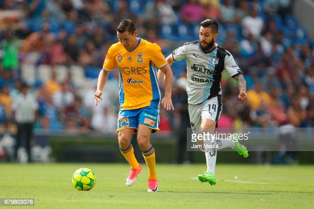 Jesus Dueñas of Tigres and Luis Noriega of Queretaro fight for the ball during a match between Queretaro against Tigres as part of the Clausura...