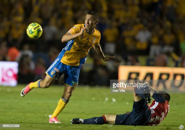 Jesus Dueñas of Tigres and Michael Perez of Chivas compete for the ball during the Final first leg match between Tigres UANL and Chivas as part of...