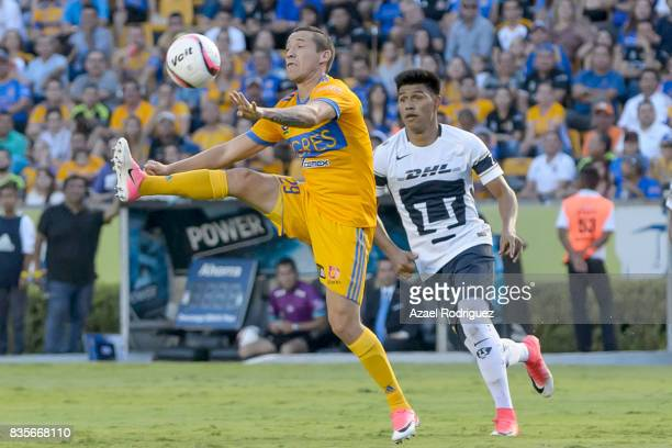 Jesus Dueñas of Tigres controls the ball during the 5th round match between Tigres and Pumas as part of the Torneo Apertura 2017 Liga MX at...