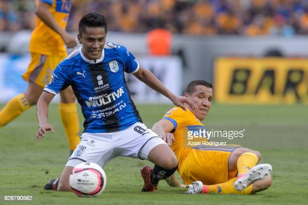 Jesus Dueñas of Tigres fights for the ball with Aldo Arellano of Queretaro during the 3rd round match between Tigres UANL and Puebla as part of the...