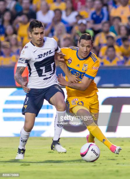 Jesus Dueñas of Tigres fights for the ball with David Cabrera of Pumas during the 5th round match between Tigres and Pumas as part of the Torneo...