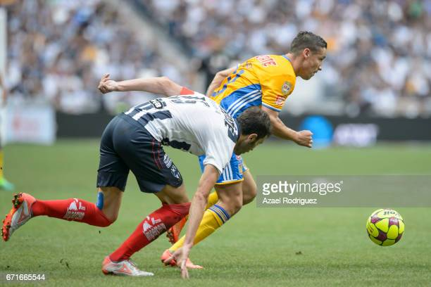 Jesus Dueñas of Tigres fights for the ball with Jose Maria Basanta of Monterrey during the 15th round match between Monterrey and Tigres UANL as part...
