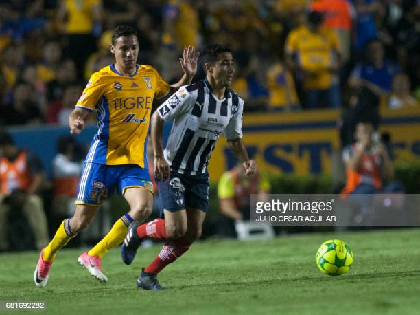 Jesus Dueñas of Tigres vies for the ball with Luis Fuentes of Monterrey during the first leg of quarterfinal of Mexican Clausura 2017 tournament...