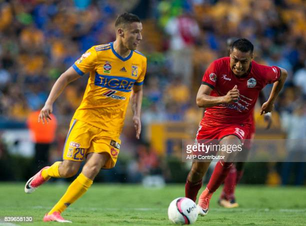 Jesus Dueñas of Tigres vies for the ball with Omar Tejeda of Lobos Buap during their Mexican Apertura 2017 tournament football match at the...