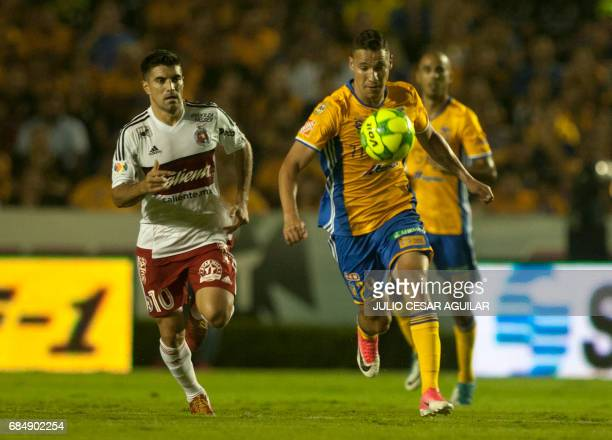 Jesus Dueñas of Tigres vies for the ball with Victor Malcoma of Tijuana during the first leg of semifinal of Mexican Clausura 2017 tournament...