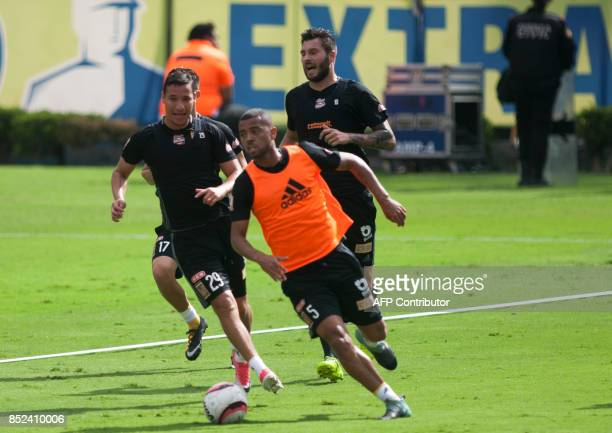 Jesus Duenas and Rafael Carioca of Tigres vie for the ball during an exhibition match to support victims of the earthquake in Monterrey on September...