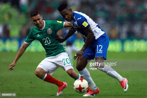 Jesus Duenas of Mexico fights for the ball with Boniek Garcia of Honduras during the match between Mexico and Honduras as part of the FIFA 2018 World...