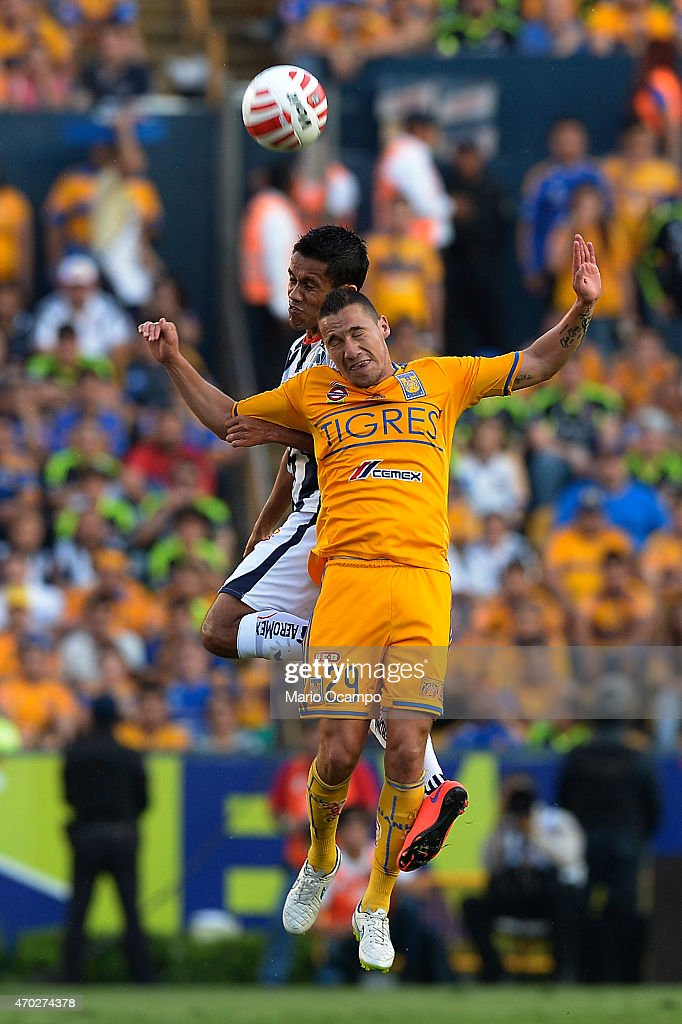 Jesus Duenas of Tigres and Severo Meza of Monterrey jump to head the ball during a match between Tigres UANL and Monterrey as part of 14th round...