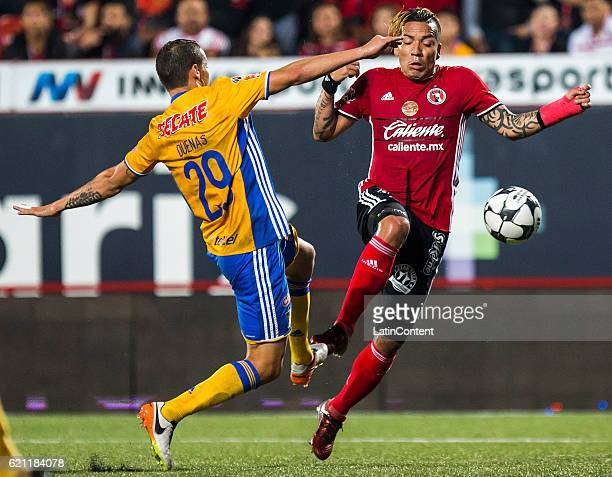 Jesus Duenas of Tigres fights for the ball with Dayro Moreno of Xolos during the 16th round match between Tijuana and Tigres UANL as part of the...