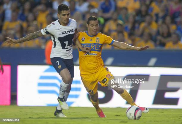 Jesus Duenas of Tigres vies for the ball with David Cabrera of Pumas during their Mexican Apertura 2017 tournament football match at the...