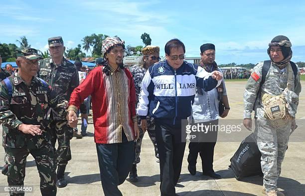 Jesus Dureza Philippine presidential peace adviser secretary with Muslim rebel leader Nur Misuari of the Moro National Liberation Front and military...
