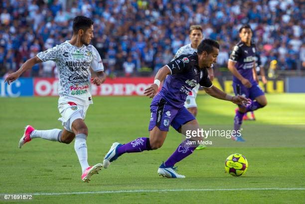 Jesus Escoboza of Jaguares and Camilo Da Silva Sanvezzo of Queretaro fight for the ball during the 15th round match between Queretaro and Jaguares as...