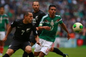 Jesus Escoboza of Mexico struggles for the ball with Leo Bertos of New Zealand during a match between Mexico and New Zealand as part of the FIFA...