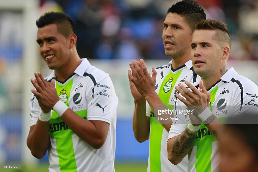 Jesus Escoboza, <a gi-track='captionPersonalityLinkClicked' href=/galleries/search?phrase=Oribe+Peralta&family=editorial&specificpeople=2496229 ng-click='$event.stopPropagation()'>Oribe Peralta</a> and Mauro Cejas of Santos clap during a match between Pachuca and Santos as part of the Liga MX at Hidalgo stadium on September 21, 2013 in Pachuca, Mexico.