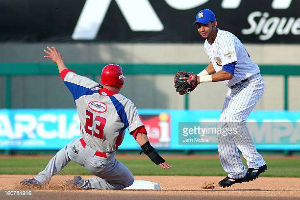 Jesus Feliciano of Puerto Rico and Osuna Renny of Venezuela in action during a match between Puerto Rico and Venezuela as part of the Caribbean...
