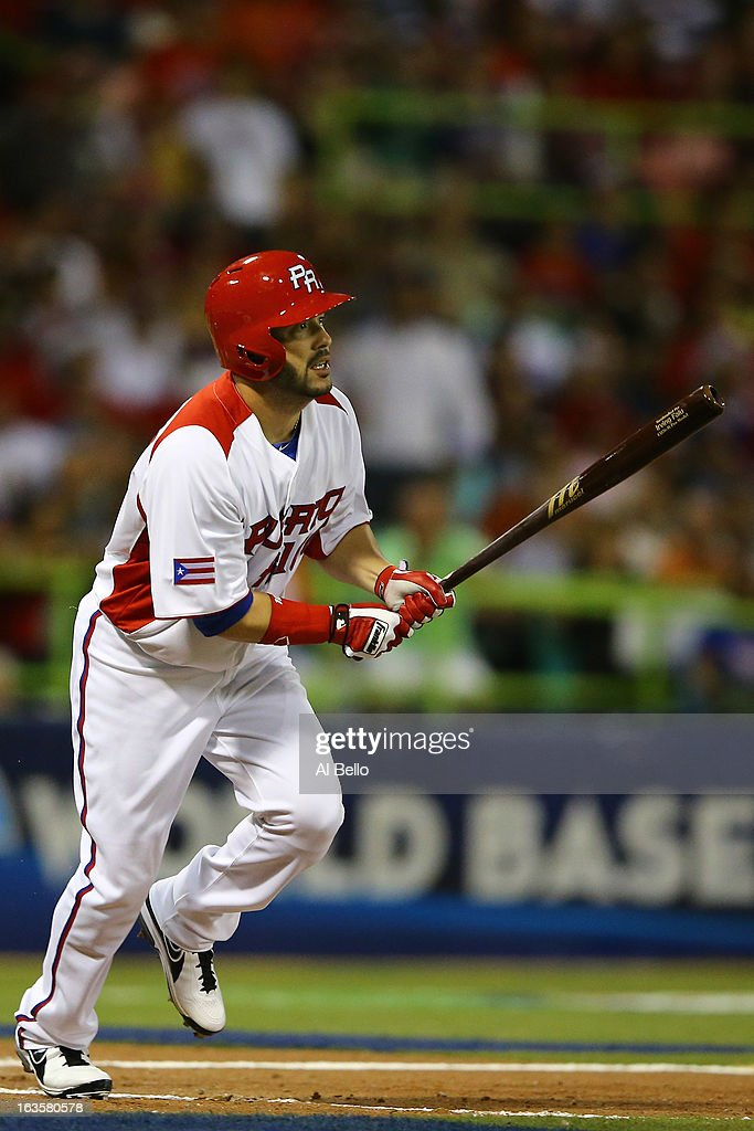 <a gi-track='captionPersonalityLinkClicked' href=/galleries/search?phrase=Jesus+Feliciano&family=editorial&specificpeople=5710825 ng-click='$event.stopPropagation()'>Jesus Feliciano</a> #13 of Puerto Rico bats against the Dominican Republic during the first round of the World Baseball Classic at Hiram Bithorn Stadium on March 10, 2013 in San Juan, Puerto Rico.