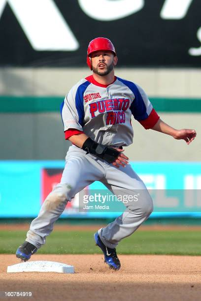 Jesus Feliciano of Puerto Rico in action during a match between Puerto Rico and Venezuela as part of the Caribbean Series 2013 at Sonora Stadium on...
