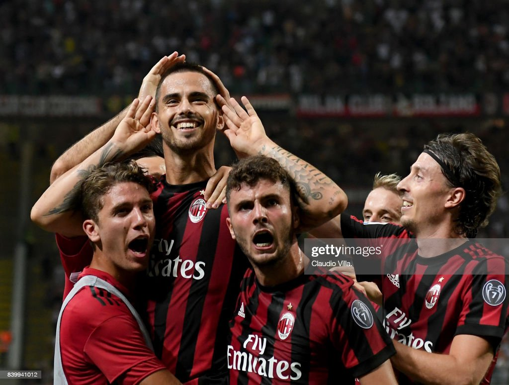 Jesus Fernandez Saez Suso of AC Milan (C) celebrates after scoring the second goal during the Serie A match between AC Milan and Cagliari Calcio at Stadio Giuseppe Meazza on August 27, 2017 in Milan, Italy.