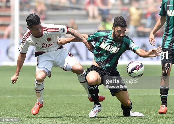 Jesus Fernandez Suso of Milan and Francesco Magnanelli of Sassuolo in action during the Serie A match between US Sassuolo Calcio and AC Milan on May...