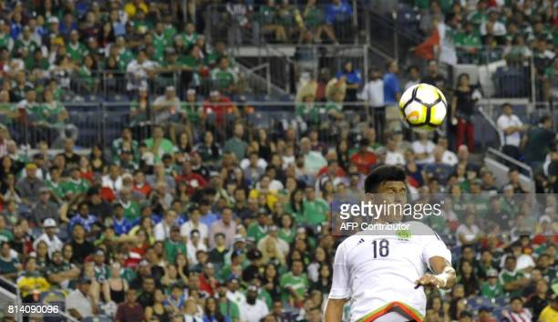 Jesus Gallardo of Mexico wins the battle for a head ball during the Mexico vs Jamaica CONCACAF Group C Gold Cup soccer game on July 13 2017 at Sports...